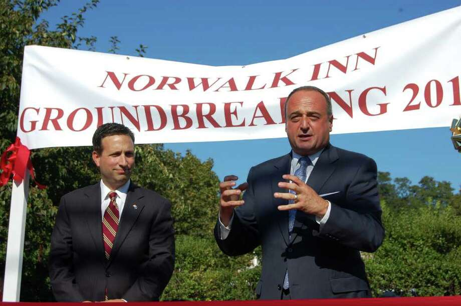 State Sen. Bob Duff (D-Norwalk) and state Rep. Larry Cafero (R-Norwalk) helped hammer out an agreement with representatives from the Norwalk Inn, the Norwalk Preservation Trust and neighbors. The result is a multi-million dollar expansion/renovation of the inn, a project they were on hand to break ground on Tuesday afternoon at the inn. Photo: Photo By Nicole Rivard
