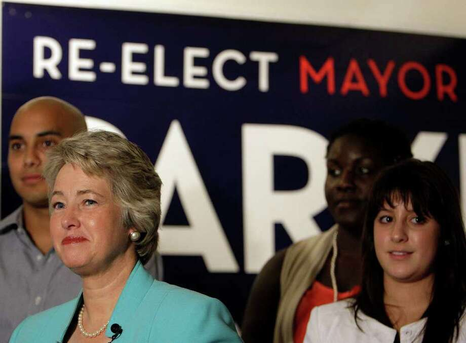 "Mayor Annise Parker — backed by ""Parker fellows,"" college student volunteers — on Thursday announces her intention to seek a second term as mayor Photo: James Nielsen, Staff / © 2011 Houston Chronicle"