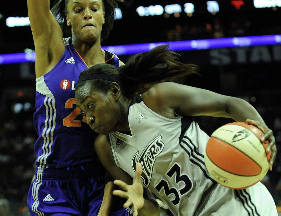 Sophia Young (33) of the San Antonio Silver Spurs drives to the hoop as DeWanna Bonner of the Phoenix Mercury defends during WNBA action at the AT&T Center on Thursday, Sept. 1, 2011. BILLY CALZADA / gcalzada@express-news.net Photo: BILLY CALZADA, Express-News / gcalzada@express-news.net
