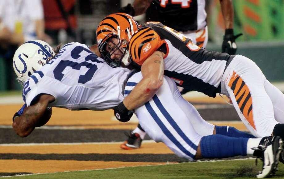 Colts 13, Bengals 13     Colts running back Darren Evans (32) scores on a one-yard touchdown run against Bengals linebacker Dan Skuta. Photo: Tony Tribble, Associated Press / FR66264 AP