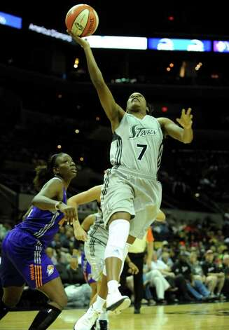 Jia Perkins drives and shoots against the Phoenix Mercury during WNBA action at the AT&T Center on Thursday, Sept. 1, 2011. BILLY CALZADA / gcalzada@express-news.net  Phoenix Mercury at San Antonio Silver Stars Photo: BILLY CALZADA, Express-News / gcalzada@express-news.net