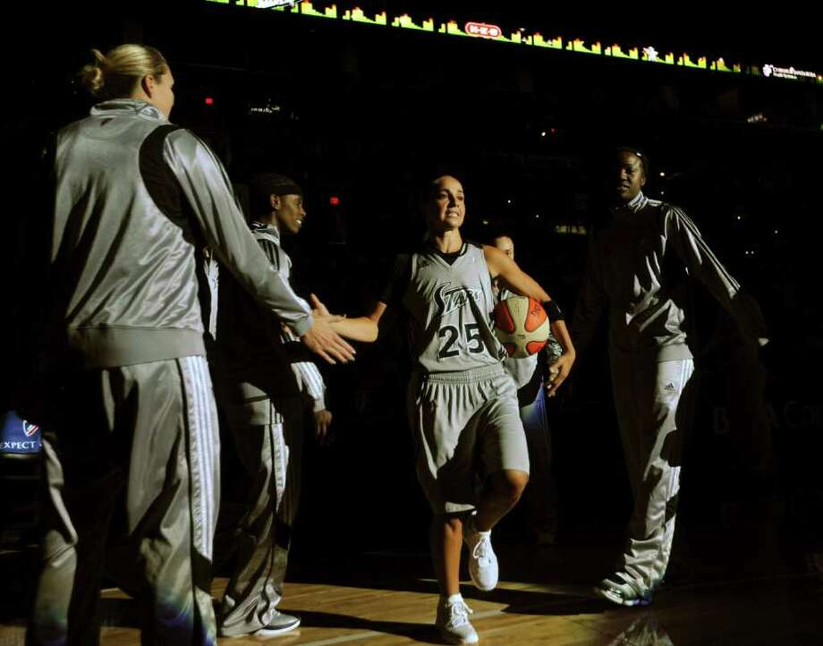 Becky Hammon of the San Antonio Silver Stars (25) is introduced prior to the team's WNBA game against the Phoenix Mercury at the AT&T Center on Thursday, Sept. 1, 2011. BILLY CALZADA / gcalzada@express-news.net