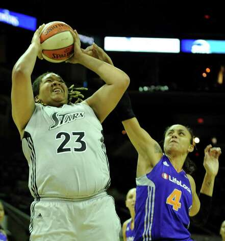 Danielle Adams (23) of the San Antonio Silver Stars is fouled by Candice Dupree (4) of the Phoenix Mercury during WNBA action at the AT&T Center on Thursday, Sept. 1, 2011. BILLY CALZADA / gcalzada@express-news.net  Phoenix Mercury at San Antonio Silver Stars Photo: BILLY CALZADA, Express-News / gcalzada@express-news.net