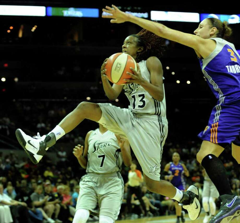 Danielle Robinson (13)  of the San Antonio Silver Stars penetrates by Diana Taurasi of the Phoenix Mercury during WNBA action at the AT&T Center on Thursday, Sept. 1, 2011. BILLY CALZADA / gcalzada@express-news.net  Phoenix Mercury at San Antonio Silver Stars Photo: BILLY CALZADA, Express-News / gcalzada@express-news.net