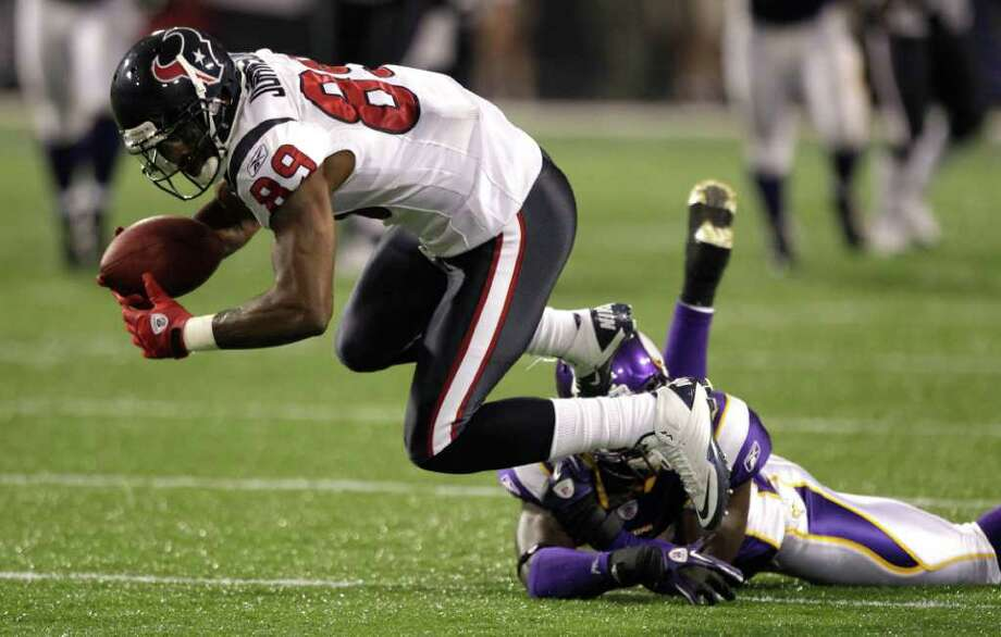 Houston Texans wide receiver Bryant Johnson (89) is tripped up by Minnesota Vikings defensive back Ryan Hill (43) during the third quarter of an NFL preseason football game at the Hubert H. Humphrey Metrodome Thursday, Sept. 1, 2011, Minneapolis. Photo: Brett Coomer, Houston Chronicle / © 2011 Houston Chronicle