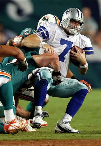 Dallas Cowboys quarterback Stephen McGee (7)) is sacked by Miami Dolphins linebacker Jason Trusnik during the first half of an NFL preseason football game on Thursday, Sept. 1, 2011, in Miami. (AP Photo/Hans Deryk) Photo: Hans Deryk, Associated Press / FR15679 AP
