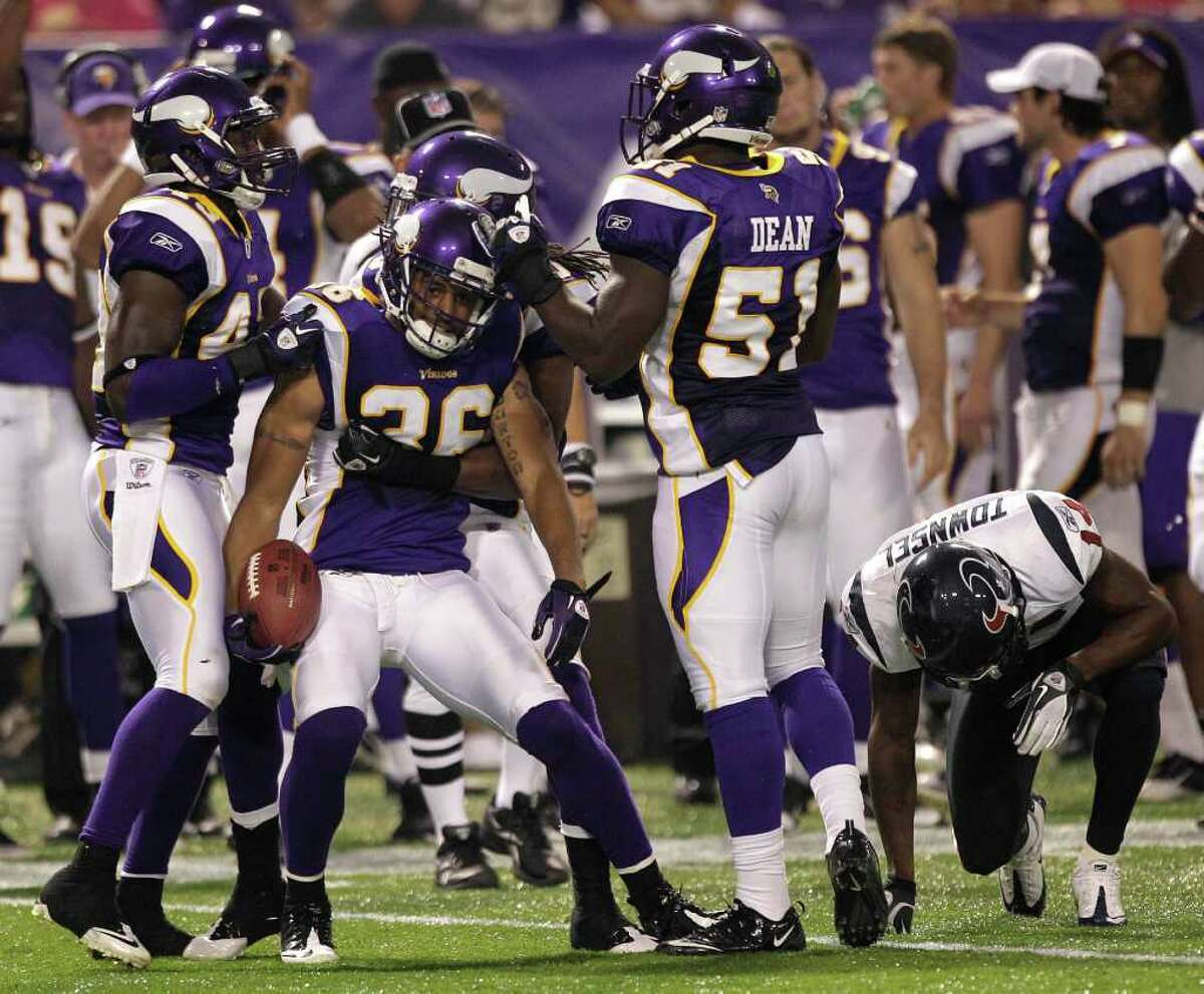 Minnesota Vikings defensive back Brandon Burton (36) is surrouned by his teammates after intercepting a pass intended for Houston Texans wide receiver Derrick Townsel (14) during the third quarter of an NFL preseason football game at the Hubert H. Humphrey Metrodome Thursday, Sept. 1, 2011, Minneapolis.