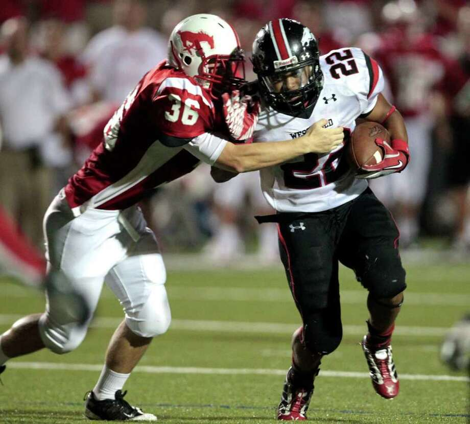 Memorial's Turner Munden attempts to tackle Westfield running back Kaylon Jackson during the second half of a high school football game at Tully Stadium,  Thursday, September 1, 2011. Photo: Billy Smith / © 2011 Houston Chronicle