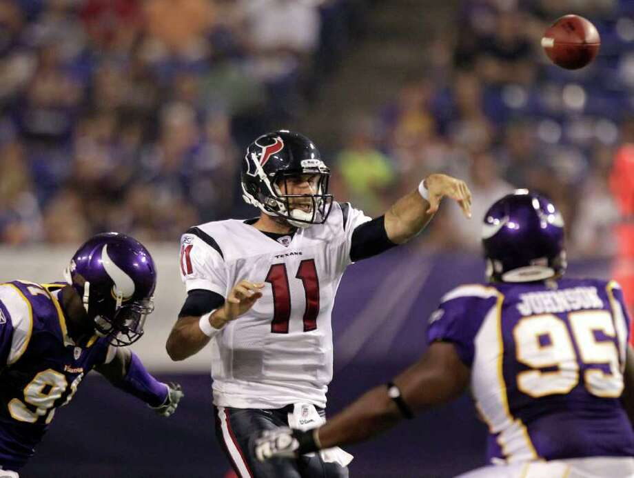Houston Texans quarterback Matt Leinart (11) throws a pass while pressured by Minnesota Vikings defensive end D'Aundre Reed (91) and defensive tackle Tremaine Johnson (95) during the second quarter of an NFL preseason football game at the Hubert H. Humphrey Metrodome Thursday, Sept. 1, 2011, Minneapolis. Photo: Brett Coomer, Houston Chronicle / © 2011 Houston Chronicle