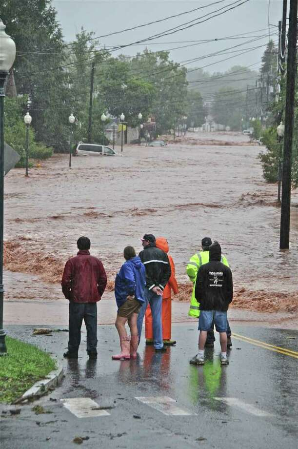 Emergency workers watch as flood waters pour into Windham, damaging the popular ski towns commercial strip. (Lance Wheeler / Special to the Times Union)