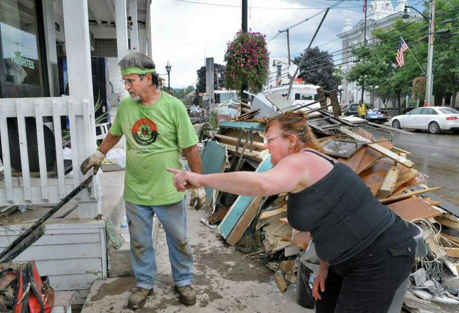 Russell Van Allen, left, and shop owner Leslie Price outside her flood damaged building on Main Street in the Village of Schoharie Thursday Sept. 1, 2011.   (John Carl D'Annibale / Times Union) Photo: John Carl D'Annibale / 10014489A