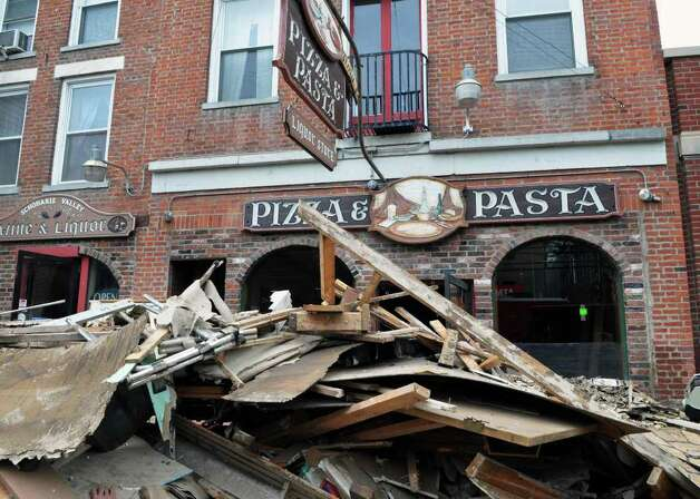 Storm debris piled up on the sidewalk on Main Street in the Village of Schoharie Thursday Sept. 1, 2011.   (John Carl D'Annibale / Times Union) Photo: John Carl D'Annibale / 10014489A