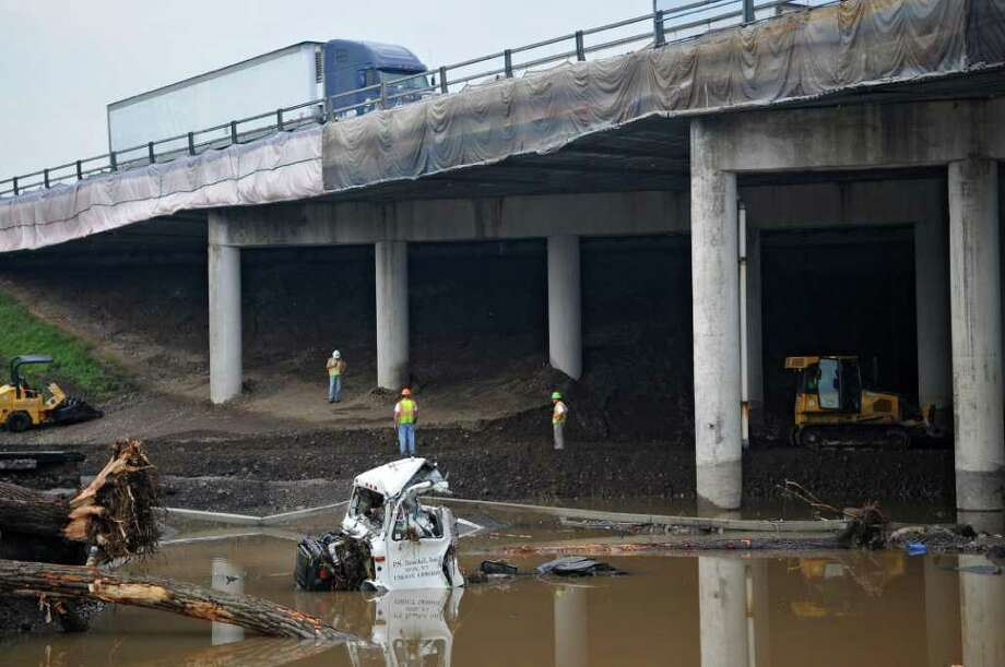 Route 5S was washed out by Tropical Storm Irene as it crosses underneath the NYS Thruway, as repair work continues on Thursday Sept. 1, 2011,  in the town of Amsterdam, NY. (Philip Kamrass / Times Union) Photo: Philip Kamrass / 10014489A