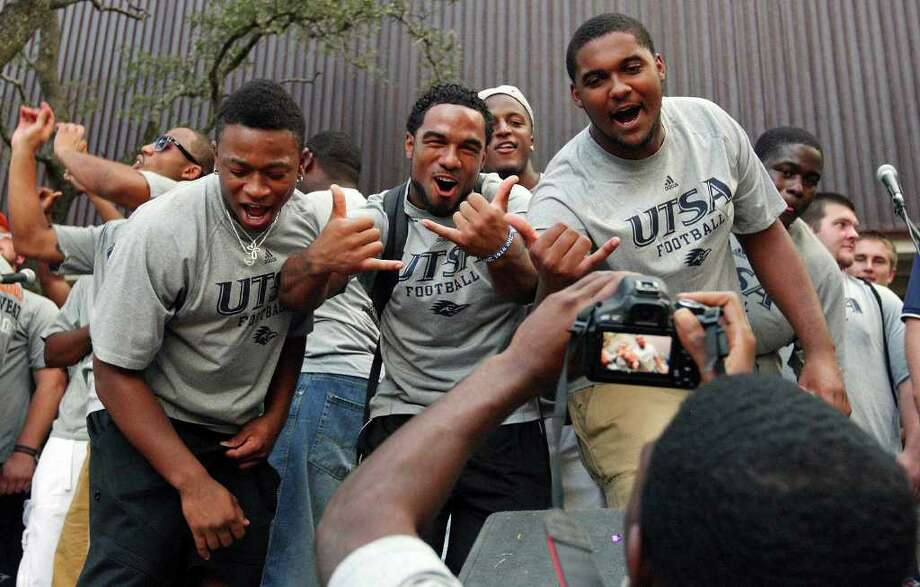 UTSA football players Josiah Monroe (from left), Mark Waters and Dominique Henderson urge on the crowd during the Howdy Rowdy Bash on campus Thursday, Sept. 1, 2011, two days ahead of the Roadrunners' first football game. Photo: Edward A. Ornelas/eaornelas@express-news.net / © SAN ANTONIO EXPRESS-NEWS (NFS)