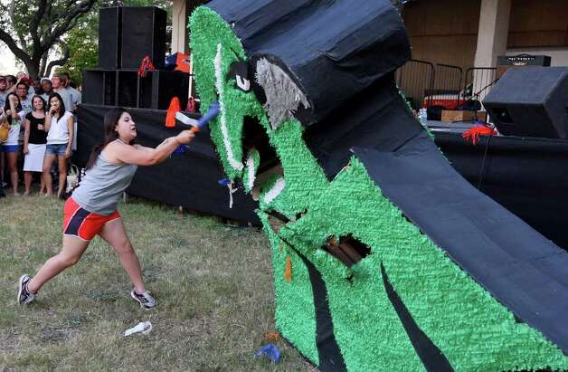 UTSA freshman Carolina Galvan hits a Northeastern State Riverhawks piñata during the Howdy Rowdy Bash on campus Thursday, Sept. 1, 2011, two days ahead of the Roadrunners' first football game. Photo: Edward A. Ornelas/eaornelas@express-news.net / © SAN ANTONIO EXPRESS-NEWS (NFS)