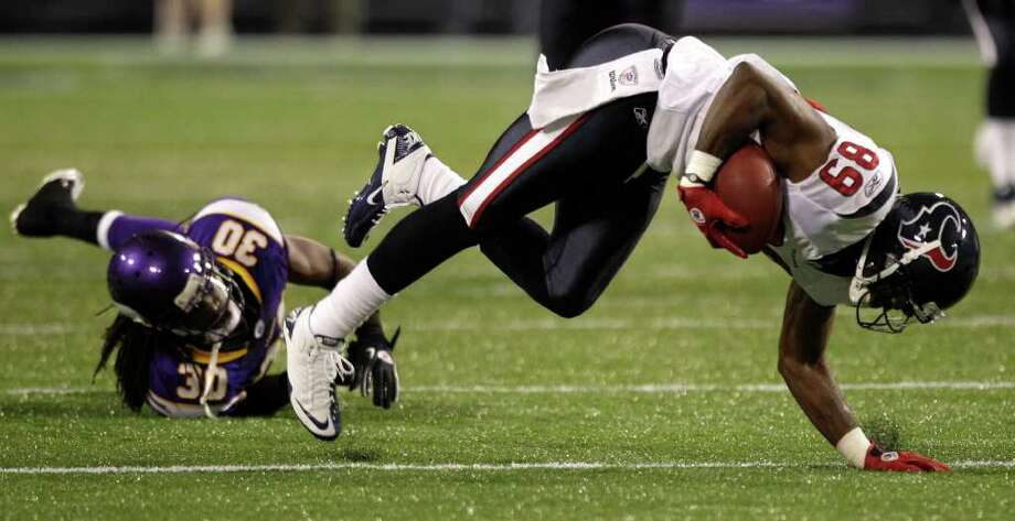 Houston Texans wide receiver Bryant Johnson (89) is tripped up by Minnesota Vikings defensive back Mistral Raymond (30) during the second quarter of an NFL preseason football game at the Hubert H. Humphrey Metrodome Thursday, Sept. 1, 2011, Minneapolis. Photo: Brett Coomer, Houston Chronicle / © 2011 Houston Chronicle
