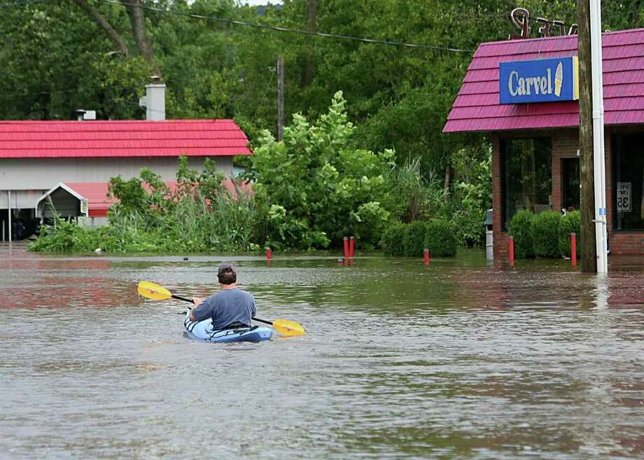 """User-submitted photo of damage from Hurricane Irene.  Submitted by Matt """"Kayaking to Carvel for a cone.  Route 7 New Milford."""" Photo: Contributed"""