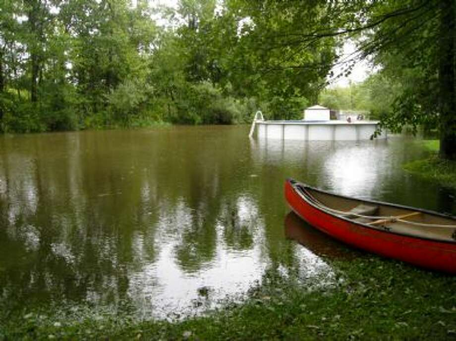 "User-submitted photo of damage from Hurricane Irene.  Submitted by KH ""swimming, anyone?"" Photo: Contributed"