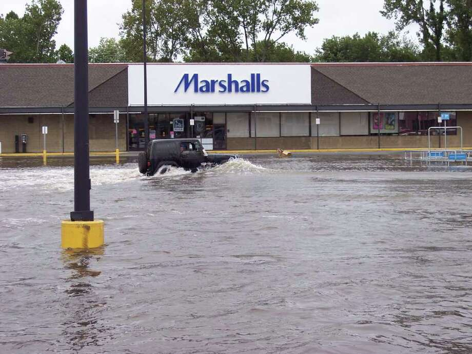 "User-submitted photo of damage from Hurricane Irene.  Submitted by GI JON ""Fording Water in the Marshalls Parking lot"" Photo: Contributed"