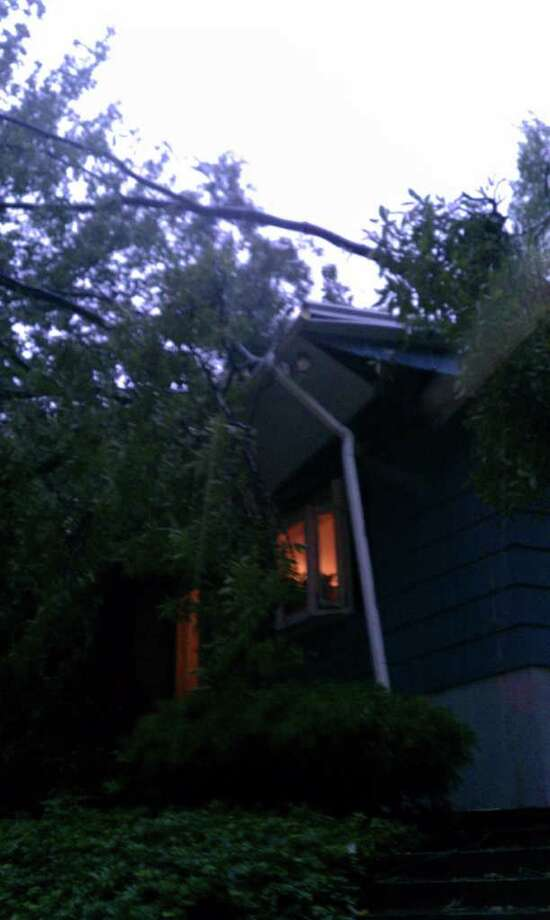 """User-submitted photo of damage from Hurricane Irene.  Submitted by scott kunz """"Woke up to the sound of a tree landing on our roof"""" Photo: Contributed"""