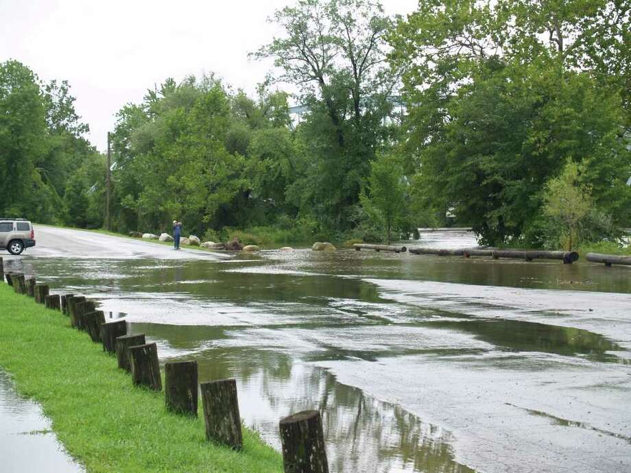 "User-submitted photo of damage from Hurricane Irene.  Submitted by Lisa ""Flooding over Youngsfield Road in New Milford near Veteran's Bridge."" Photo: Contributed"