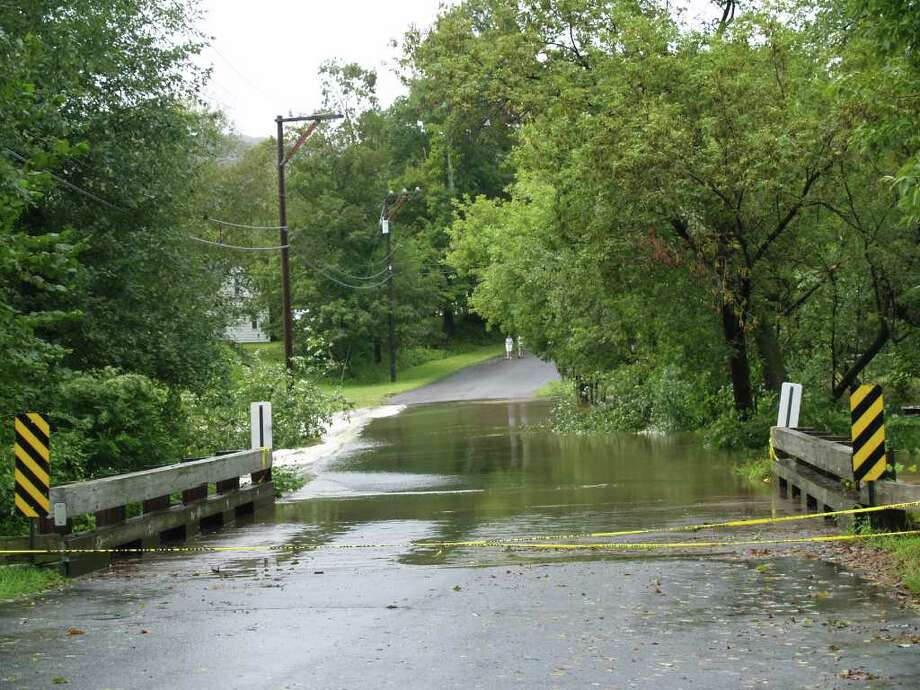 "User-submitted photo of damage from Hurricane Irene.  Submitted by Lisa ""Flooding over Wells Road Bridge on Wells Road in New Milford. Photo: Contributed"