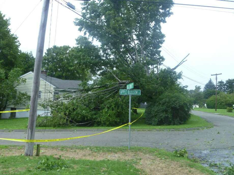 "User-submitted photo of damage from Hurricane Irene.  Submitted by Tom Brown ""Appleblossom Lane at Circle Drive closed.  Tree falls on power line"" Photo: Contributed"