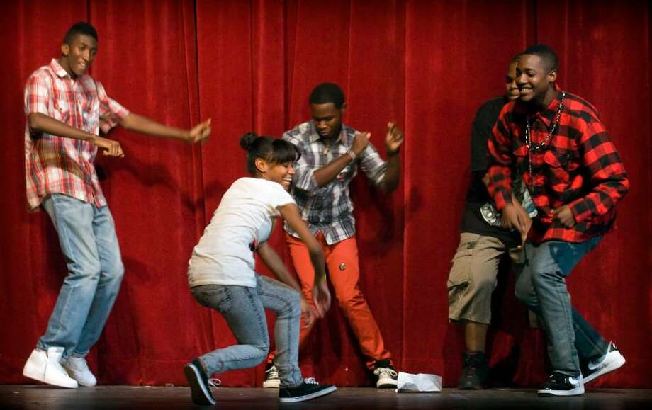 Team OD33, from left, Tyrell Taylor, Nativiana Blanco, Glenn Ortez, Steven Barosy and Kevin Parker, perform during the Jerk For Cancer dance competition at Stamford High School in Stamford, Conn. on Thursday, Oct. 15, 2009. Photo: Chris Preovolos / Stamford Advocate