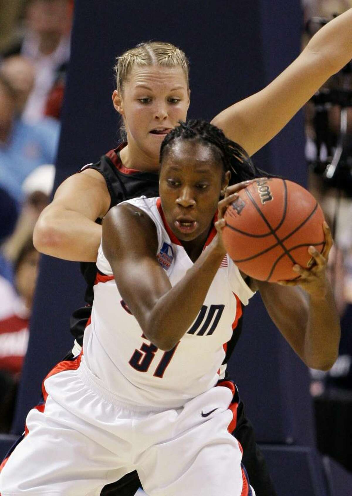 Connecticut's Tina Charles (31) moves in on Stanford's Jayne Appel in the first half in a semifinal of the NCAA women's college basketball tournament Final Four on Sunday, April 5, 2009, in St. Louis. (AP Photo/Lynne Sladky)