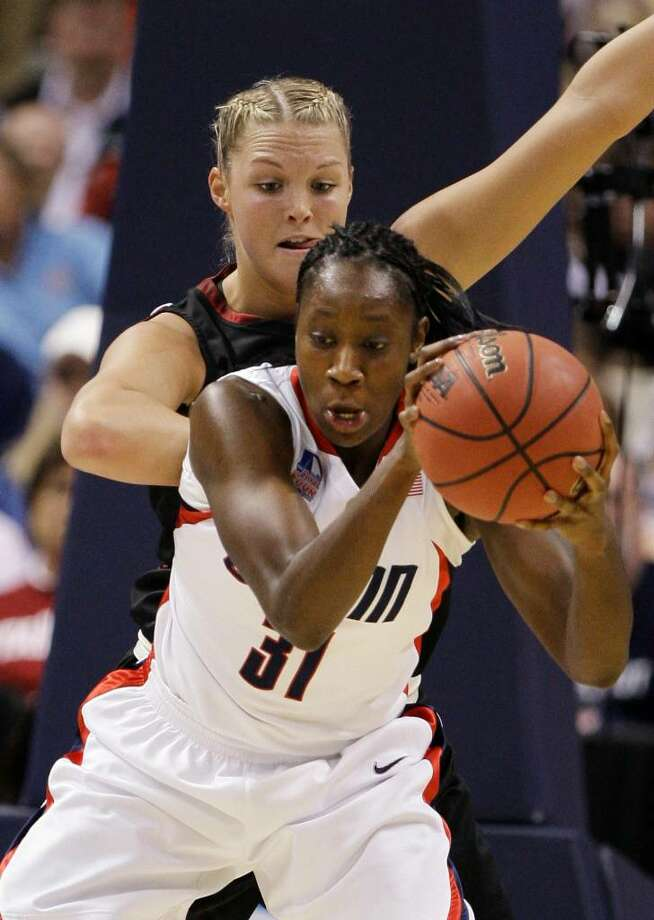 Connecticut's Tina Charles (31) moves in on Stanford's Jayne Appel in the first half in a semifinal of the NCAA women's college basketball tournament Final Four on Sunday, April 5, 2009, in St. Louis. (AP Photo/Lynne Sladky) Photo: Lynne Sladky, AP / AP