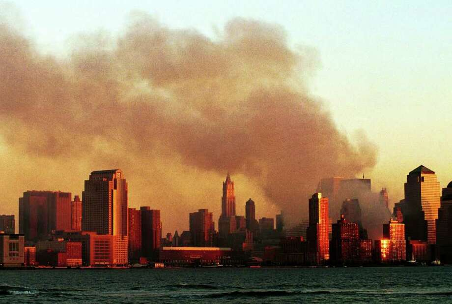 Smoke pours from the former site of the World Trade Center in Manhattan September 12, 2001 from a vantage point in Hoboken, N.J. Smoke filled the air all over lower Manhattan in the aftermath of the terrorist attack and destruction of the World Trade Center. Photo: Chris Hondros, Getty Images / Getty Images North America