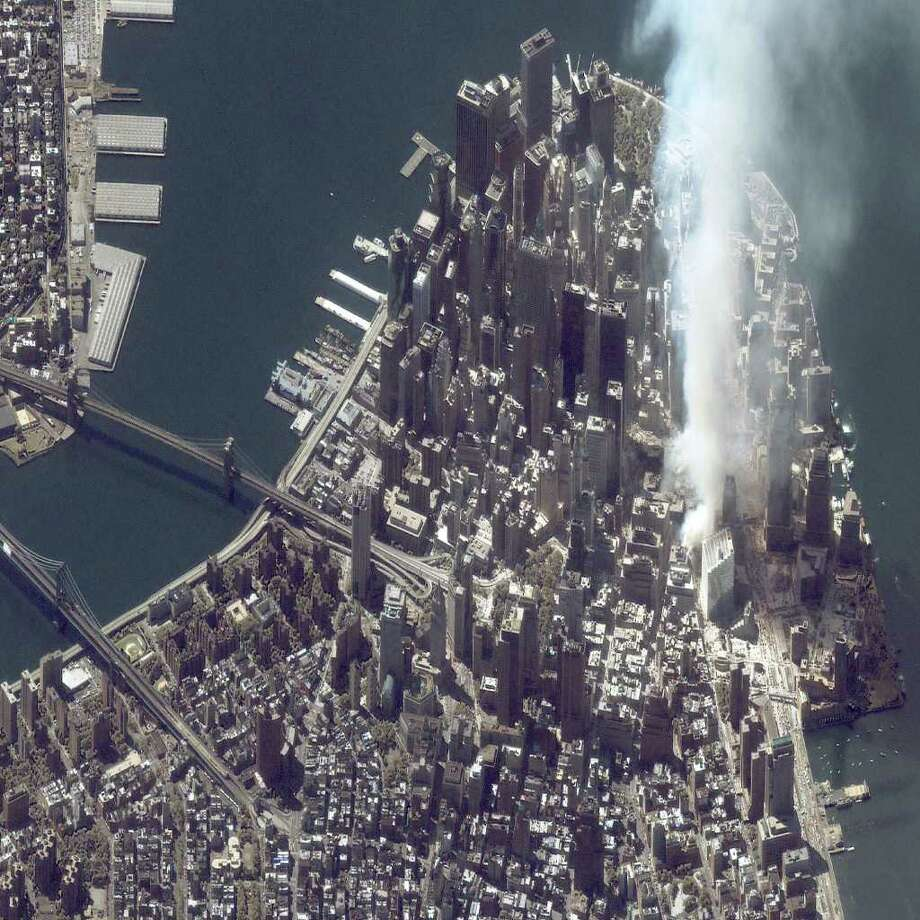 A satellite image of lower Manhattan shows smoke and ash rising from the site of the World Trade Center at 11:43 a.m. September 12, 2001 in New York City. Photo: Getty Images / Getty Images North America