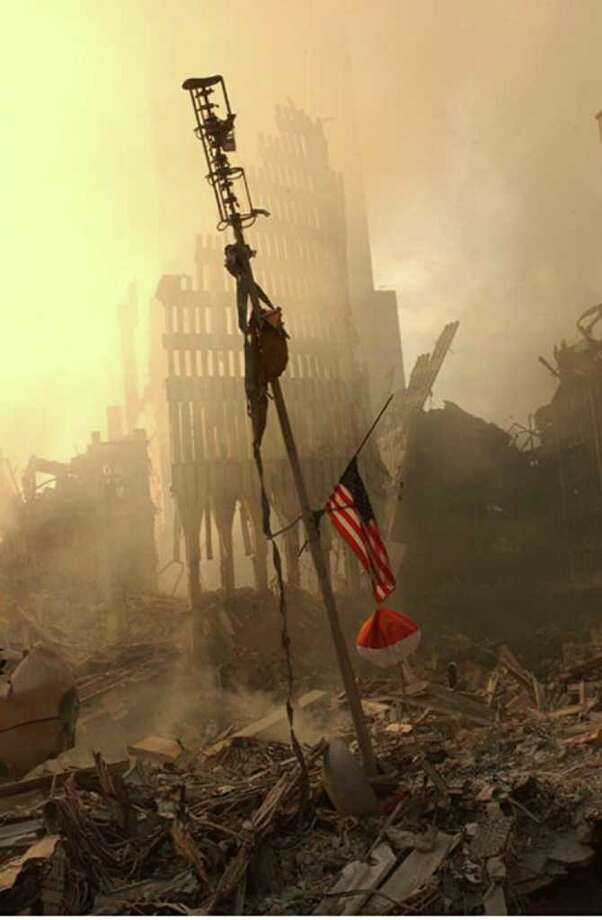 A US flag flies from a television antenna September 13, 2001 amid the rubble of the World Trade Center after an aircraft crashed into it September 11 as part of a terrorist attack. The antenna was once at the top of one of the 110 story twin towers. Photo: FEMA, Getty Images / Getty Images North America