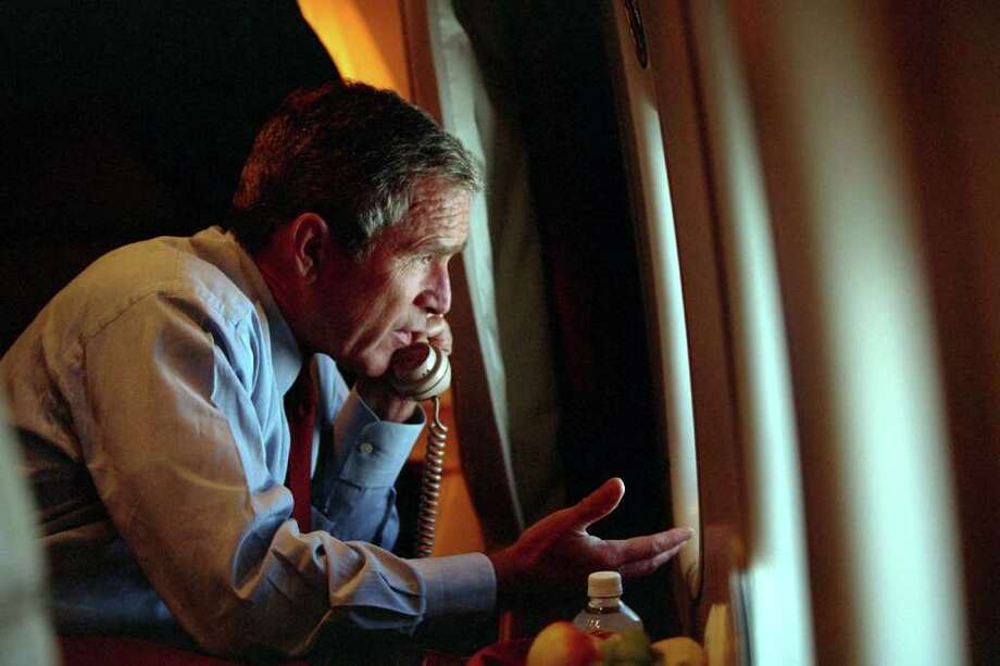 U.S. President George W. Bush speaks to Vice President Dick Cheney by phone aboard Air Force One September 11, 2001 after departing Offutt Air Force Base in Nebraska. Photo: The White House, Getty Images / Getty Images North America