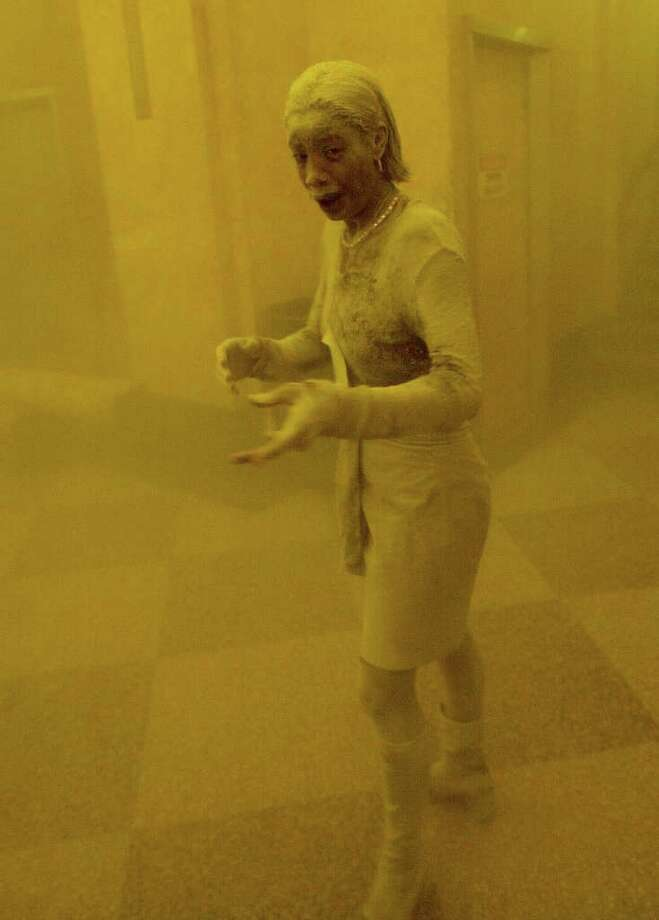 This 11 September 2001 file photo shows Marcy Borders covered in dust as she takes refuge in an office building after one of the World Trade Center towers collapsed in New York. Borders was caught outside on the street as the cloud of smoke and dust enveloped the area.  The woman was caught outside on the street as the cloud of smoke and dust enveloped the area. Photo: STAN HONDA, AFP/Getty Images / 2011 AFP