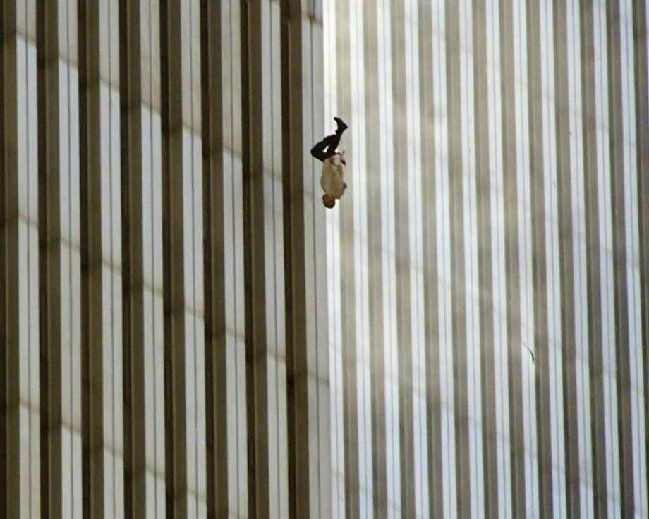 A man falls from the north tower of New York's World Trade Center on Sept. 11, 2001, after terrorists crashed two hijacked airliners into the WTC twin towers.  Photo: RICHARD DREW, ASSOCIATED PRESS / AP2001