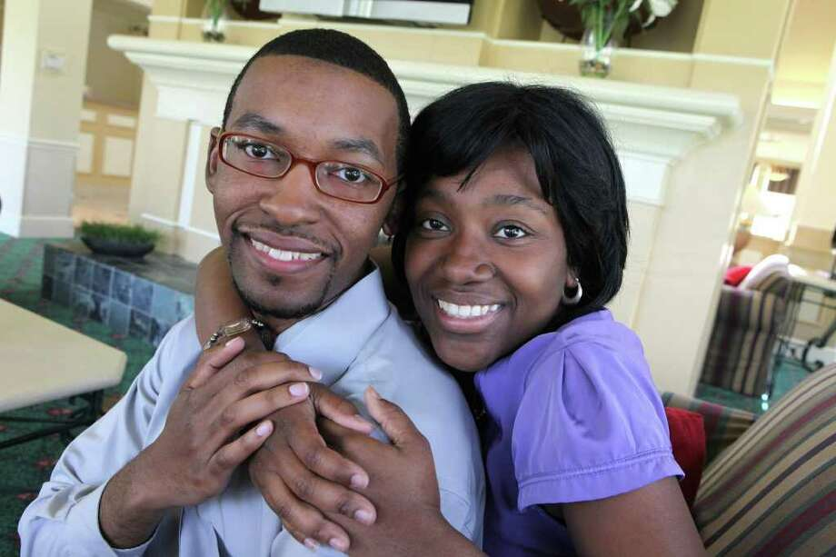"Will Thornton and Vannessa Wade (cq) are back together in Houston. Wade moved back to Houston from Washington D.C. to be with her ""one true love"". Photograph taken on July 1, 2011. (Alan Warren, For the Chronicle) Photo: Alan Warren, Photographer / ©2011 Houston Chronicle"