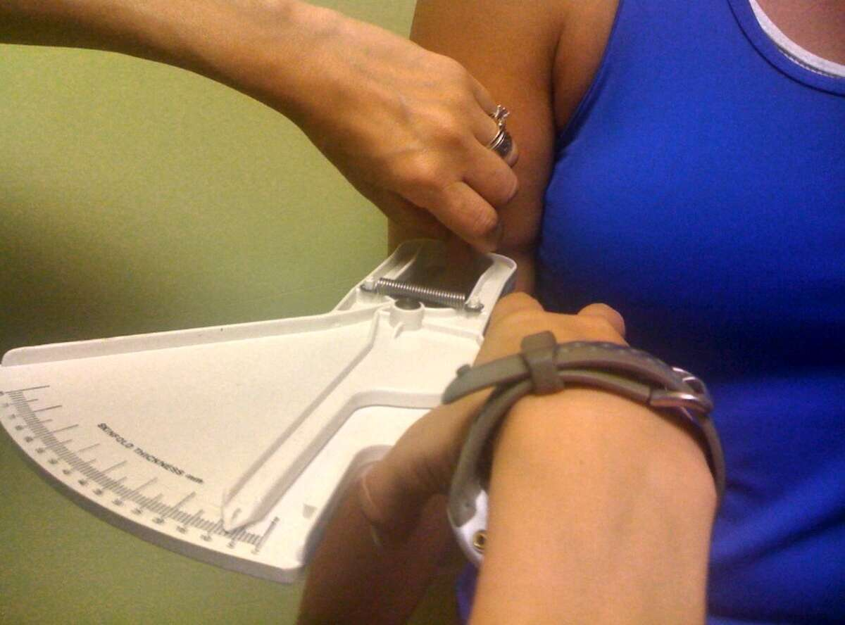 The bicep is one of four areas commonly pinched for caliper-based body fat measurements.