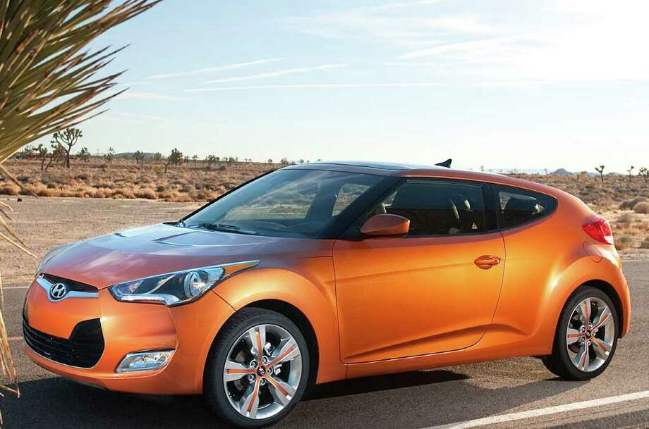 The 2012 Hyundai Veloster is designed to look like a coupe, but actually has a rear hatch. There are three passenger doors -- two in front and one on the rear passenger side. COURTESY OF HYUNDAI MOTOR AMERICA Photo: Hyundai Motor America, COURTESY OF HYUNDAI MOTOR AMERICA