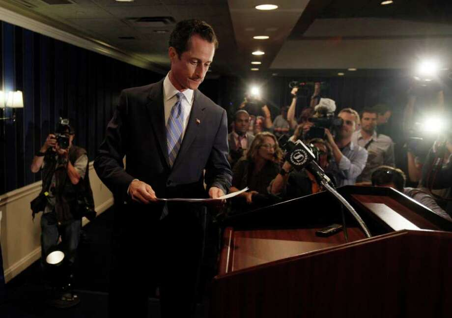 "U.S. Rep. Anthony Weiner, D-N.Y., arrives for a news conference in New York,  Monday, June 6, 2011. After days of denials, a choked-up New York Democratic Rep. Anthony Weiner confessed Monday that he tweeted a bulging-underpants photo of himself to a young woman and admitted to ""inappropriate"" exchanges with six women before and after getting married. (AP Photo/Richard Drew) Photo: Richard Drew, STF / AP"