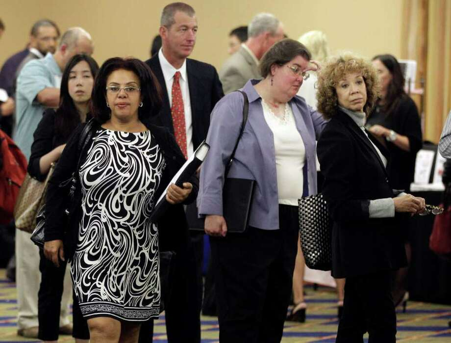 Job Seekers line up for interviews during a job fair  Thursday, Sept. 1, 2011 in San Mateo, Calif. Employers added no net workers last month and the unemployment rate was unchanged, a sign that many were nervous the U.S. economy is at risk of slipping into another recession. (AP Photo/Marcio Jose Sanchez) Photo: Marcio Jose Sanchez, STF / AP