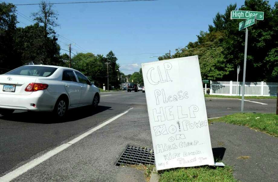 A sign pleading with Connecticut Light & Power to restore electricity along High Clear Road in Stamford stands at the intersection of High Clear and Pound Ridge Roads on Friday, September 2, 2011. Photo: Lindsay Niegelberg