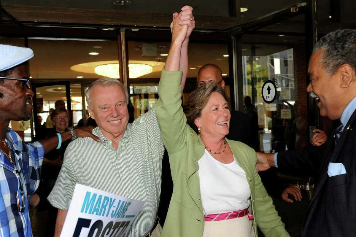 Mary-Jane Foster and her husband Jack McGregor celebrate as they exit Superior Court in Bridgeport, Conn. Sept. 2nd, 2011. Judge Barbara Bellis read her decision to place Foster back on the ballot for the democratic primary for mayor, which has been rescheduled to Sept. 27th.