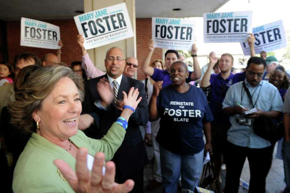 Mary-Jane Foster is greeted by supporters as she exits Superior Court in Bridgeport, Conn. Sept. 2nd, 2011. Judge Barbara Bellis read her decision to place Foster back on the ballot for the democratic primary for mayor, which has been rescheduled to Sept. 27th.