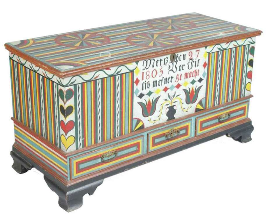 This useful but battered 19th-century blanket chest has an attractive new painted finish, so it auctioned for $450. It was accurately described in the Conestoga Auction catalog. Photo: Contributed Photo