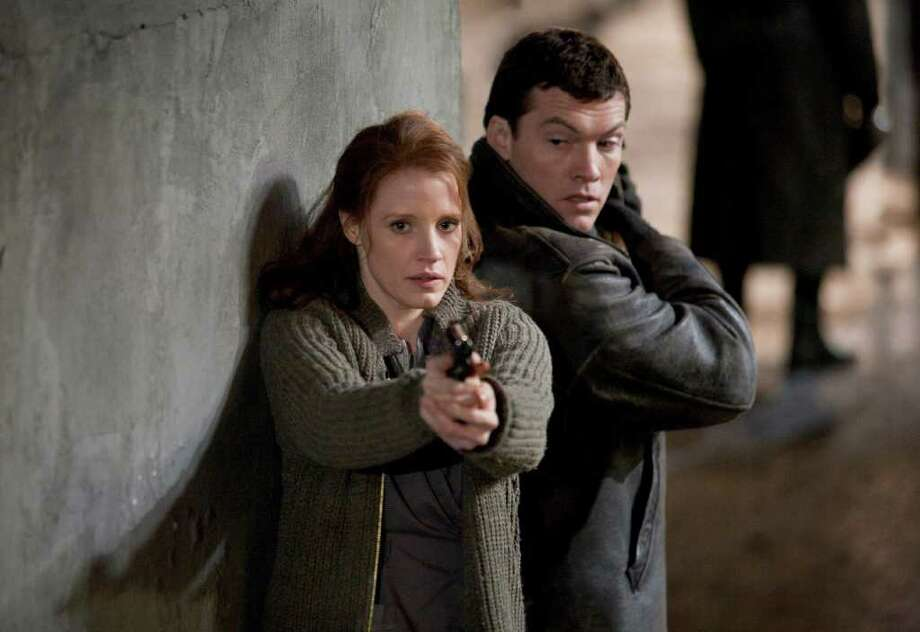 "In this film image released by Focus Features, Jessica Chastain, left, and Sam Worthington are shown in a scene from the espionage thriller ""The Debt."" (AP Photo/Focus Features, Laurie Sparham) Photo: Laurie Sparham, HONS / 2011 Focus Features"