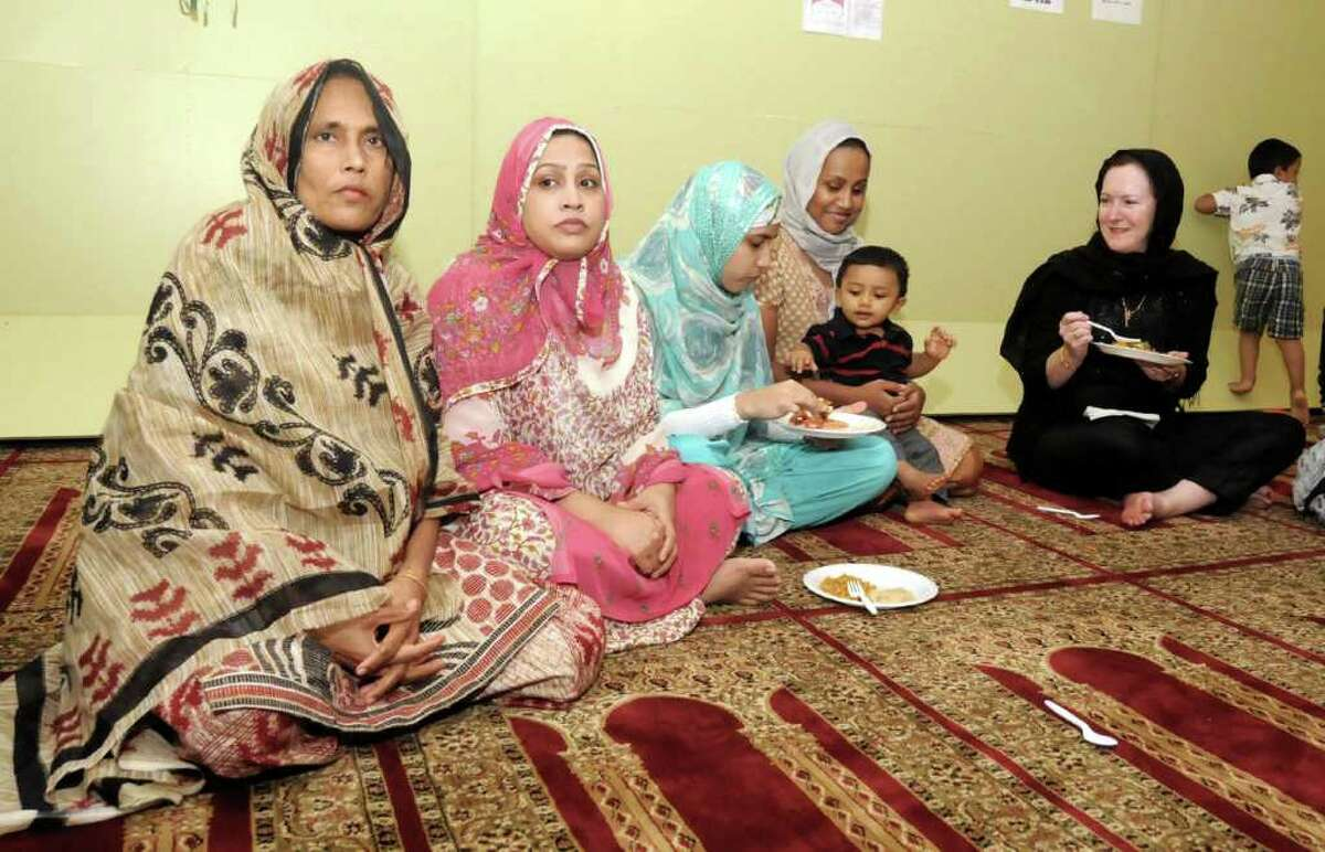 Many attended a Ramadan celebration that was held at the Baitul Mukarram Masjid of Greater Danbury Mosque on Friday August 26, 2011. From left, Danbury residents, Shahin Akther, Mahabuba Akther, Umme Habiba, Kamrun Karim and her son Aydin Hossain and Judge Dianne Yamin.