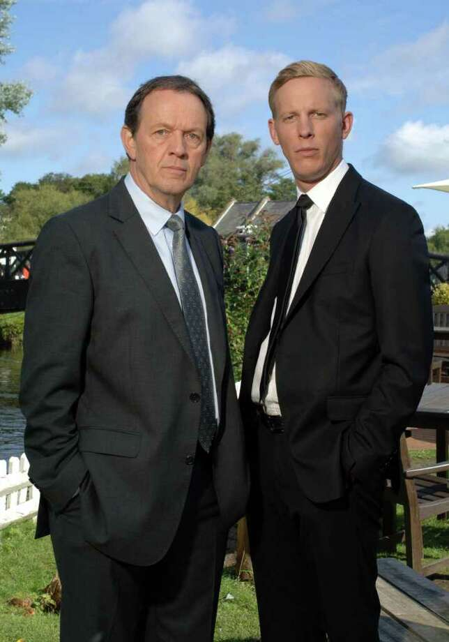 2011 AN ITV STUDIOS PRODUCTION FOR ITV1  LEWIS WILD JUSTICE  The fifth series of hit drama Lewis returns to ITV1 as Inspector Robbie Lewis and his partner DS Hathaway investigate more murders against the backdrop of Oxford and the surrounding beautiful countryside.  PICTURED: KEVIN WHATELY as DI Lewis and LAURENCE FOX as DS James Hathaway.  PHOTOGRAPHER: ROBERT DAY.