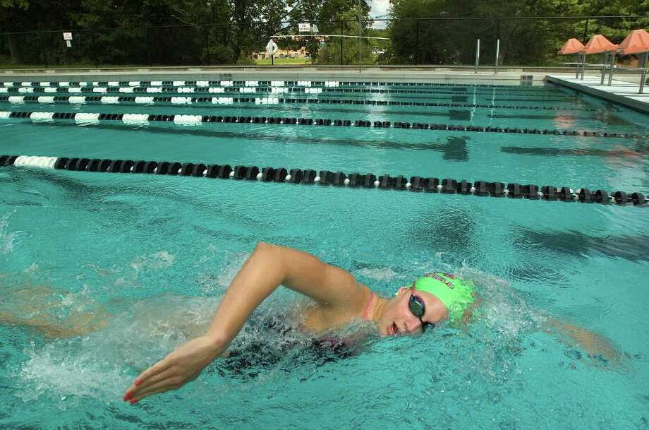 Brookfield High School's Madeline Smart does laps during practice at the Greenknoll YMCA in Brookfield on Friday, Sept. 2, 2011. Photo: Jason Rearick / The News-Times
