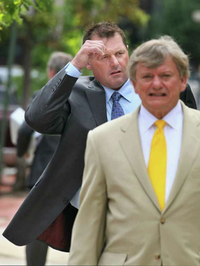 Chip Somodevilla : GETTY IMAGES HE'LL BE BACK:  Roger Clemens, left, and attorney Rusty Hardin learned Friday that they will have to return to Washington, D.C., for another trial on Clemens' perjury charge in April. Photo: Chip Somodevilla, Staff / 2011 Getty Images